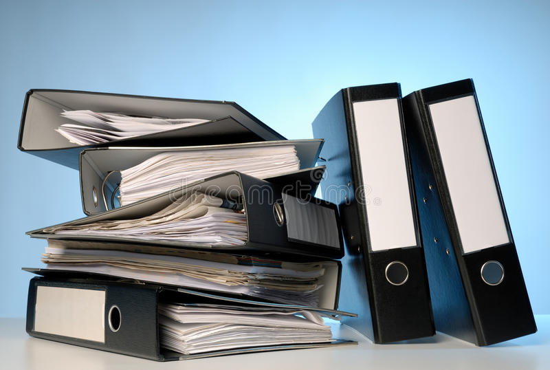 A pile of file folders. On a desk stock image