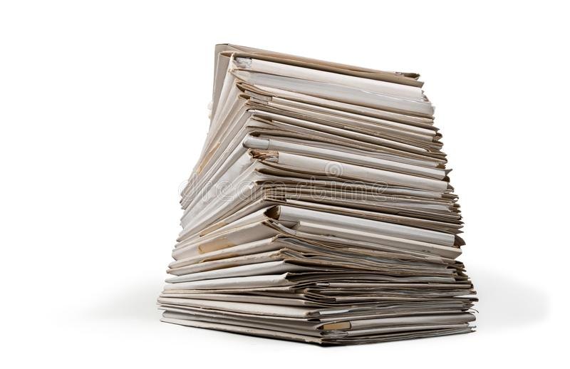 Pile of files in folders on table. Pile folders files table yellow large white royalty free stock photo