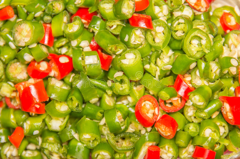A pile of finely chopped chilli peppers on background stock photography