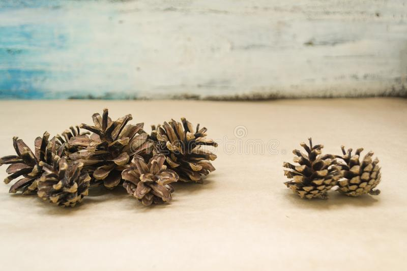 A pile of fir cones lies on the craft background. The concept of winter and Christmas.  stock image