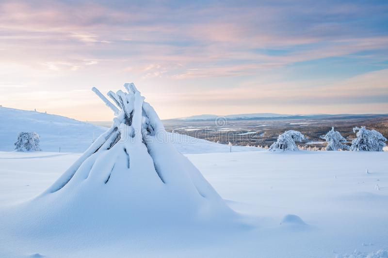 Pile Of Firewood Covers In Snow With Dramatic Sky In A Winter Day In Lapland Finland Northern Europe stock photography