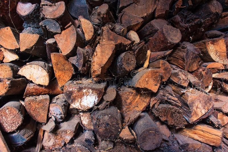 Preparation of firewood for the winter. firewood background, Stacks of firewood in the forest. Pile of firewood. stock images