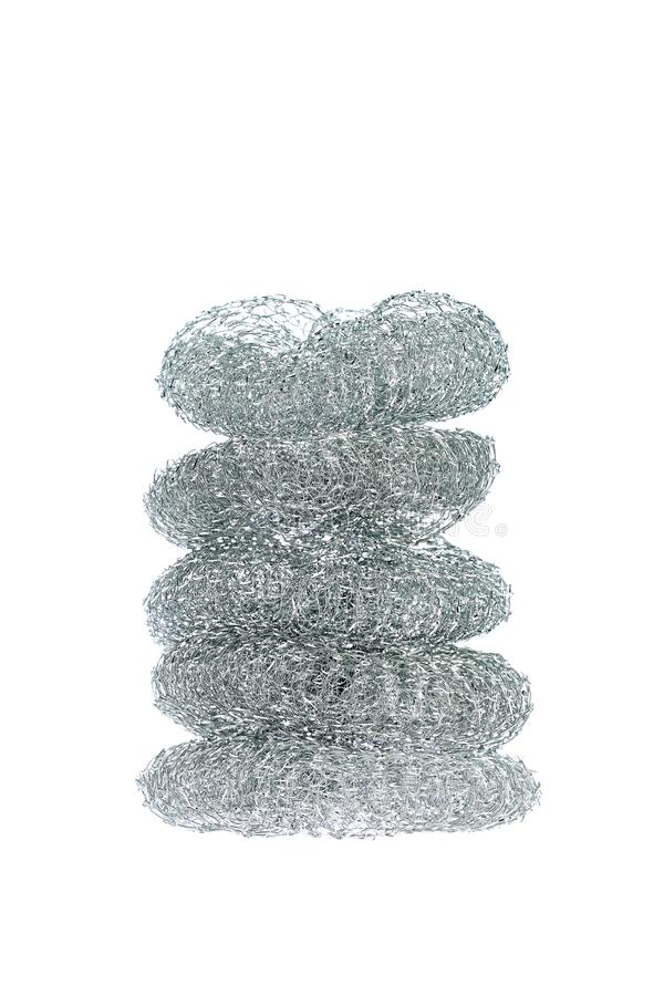 Pile of five dishwashing stainless steel wire brushes isolated on white background.  stock photography