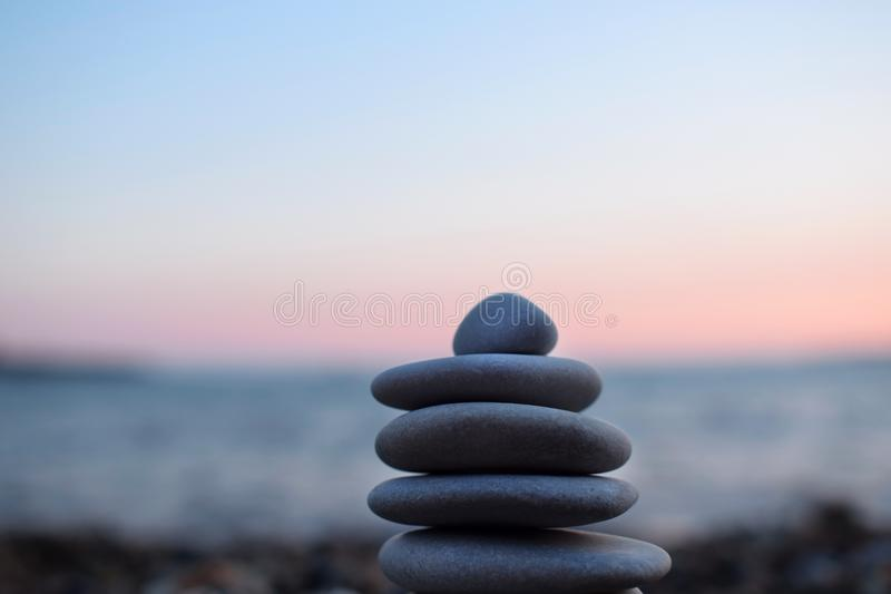 A pile of flat stones on the beach royalty free stock photos