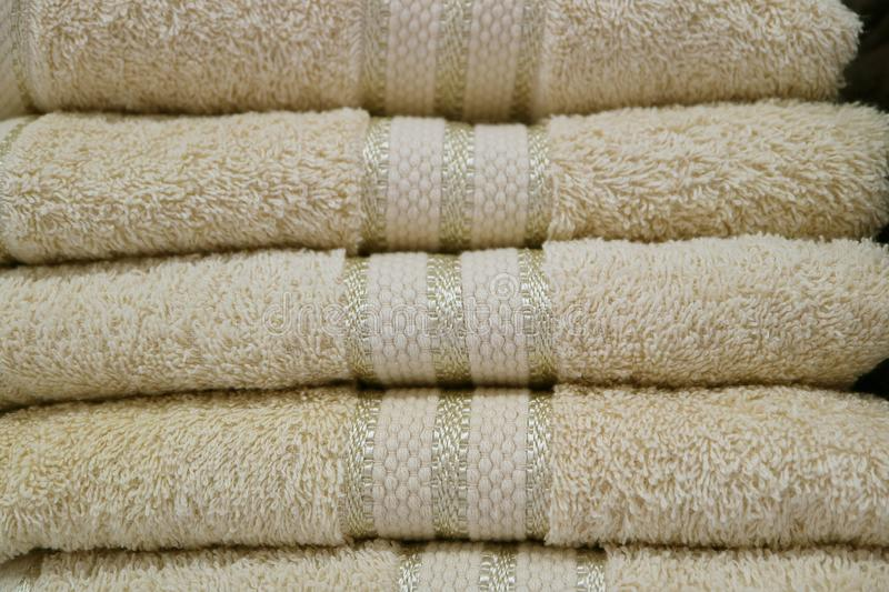 Pile of of folded off-white fluffy bath towels stock photo