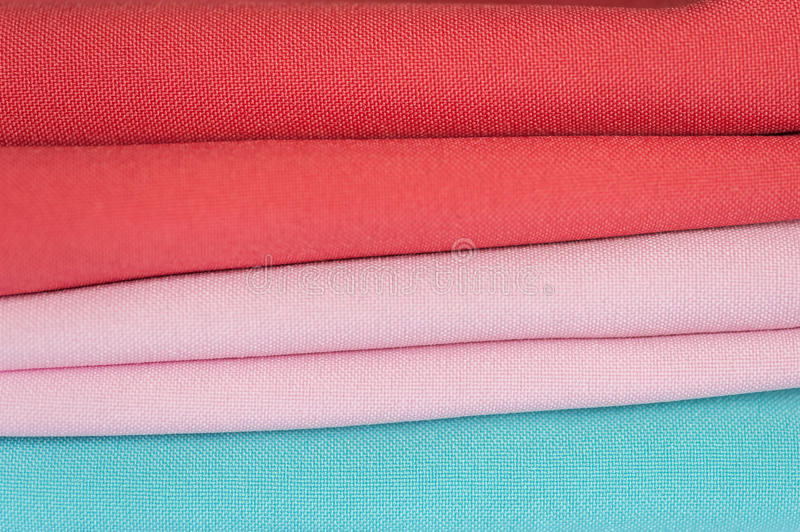 Pile of folded textile in full frame stock photography