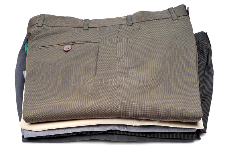 Pile of formal pants. Pile of pants isolated on white background stock photos