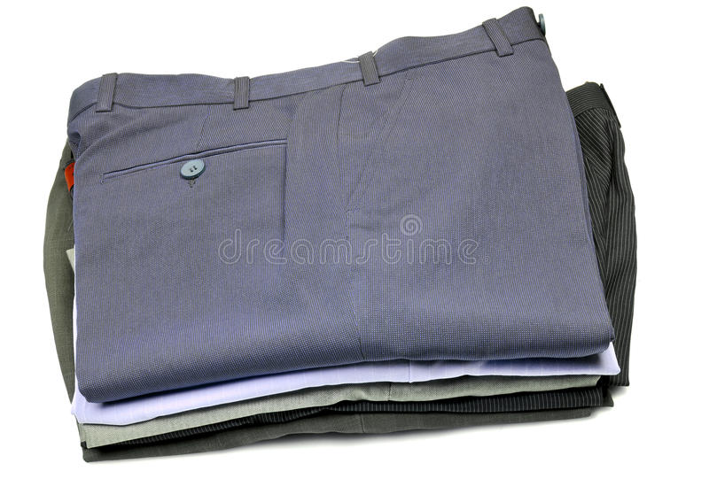 Pile of formal pants. Isolated on white background stock photos
