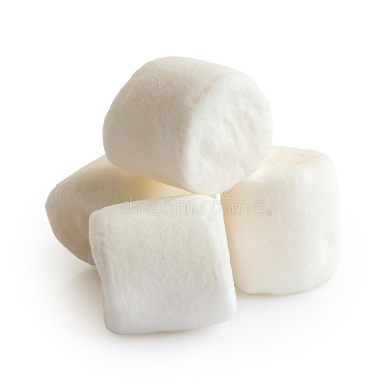 Pile of four white mini marshmallows isolated on white royalty free stock images