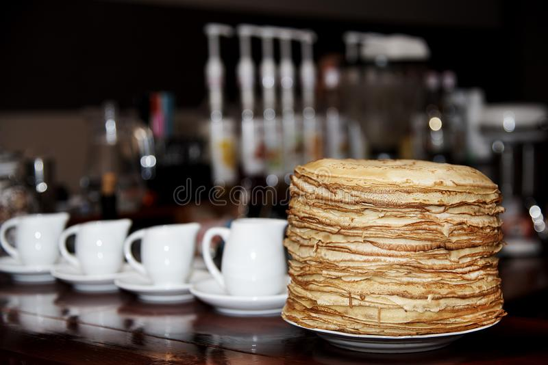 A pile of fresh cooked pancakes in a white pl royalty free stock photography