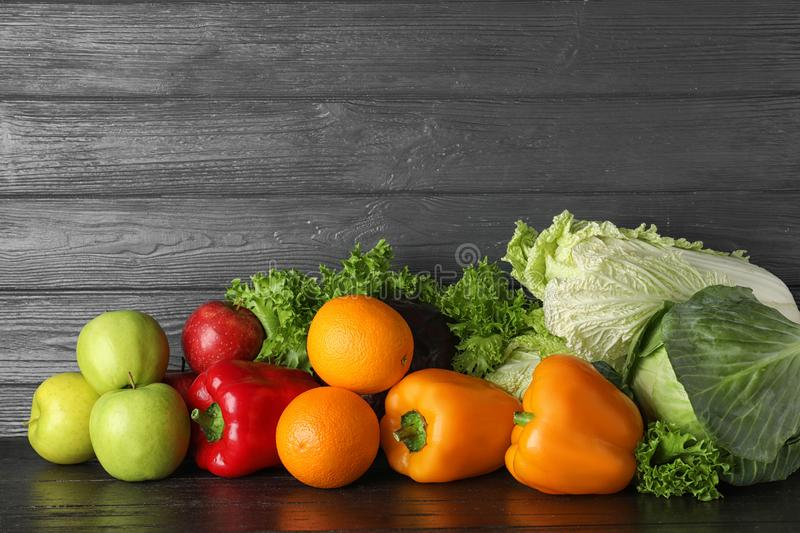Pile of fresh fruits and vegetables on black table royalty free stock photography