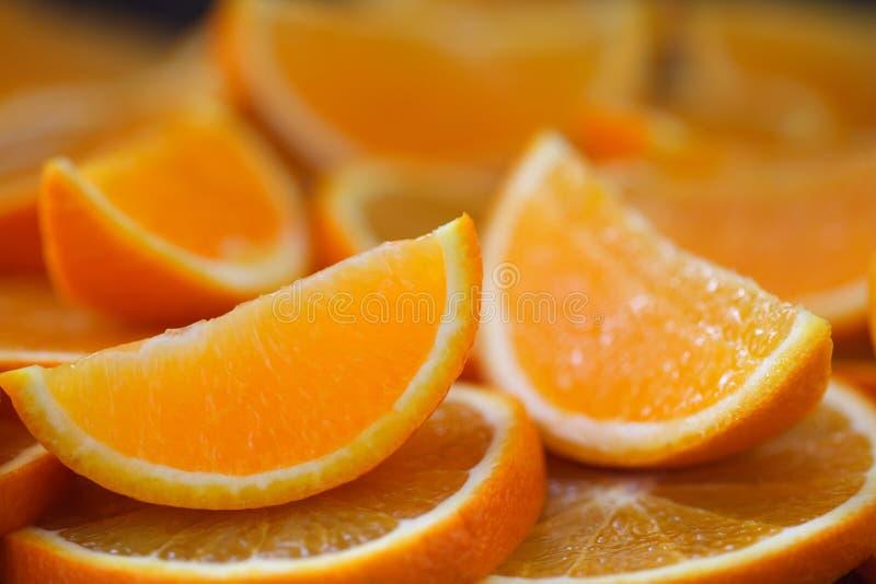 Pile of fresh orange slices royalty free stock photography