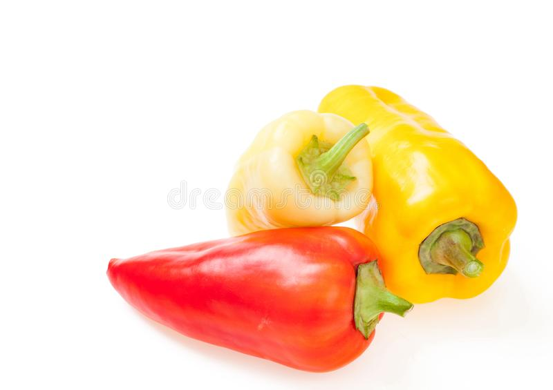Pile of fresh ripe yellow, orange and red sweet peppers. Colorful peppers isolated on white stock images
