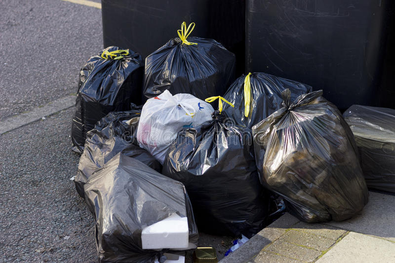 Pile of garbage bags. On a city street royalty free stock images