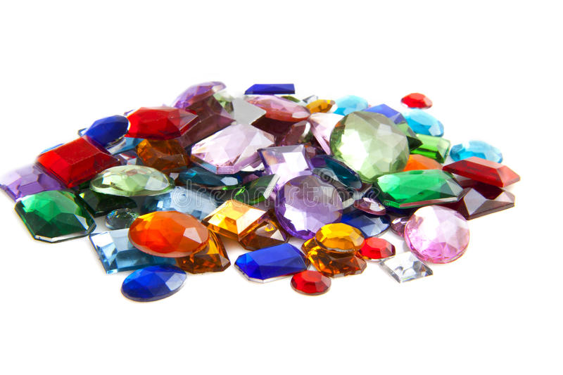 Pile of gems. Colorful gem stones isolated on a white background royalty free stock image
