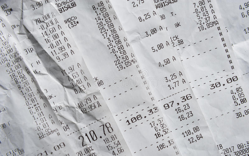 Pile Of Generic Shopping Receipts With Costs royalty free stock images