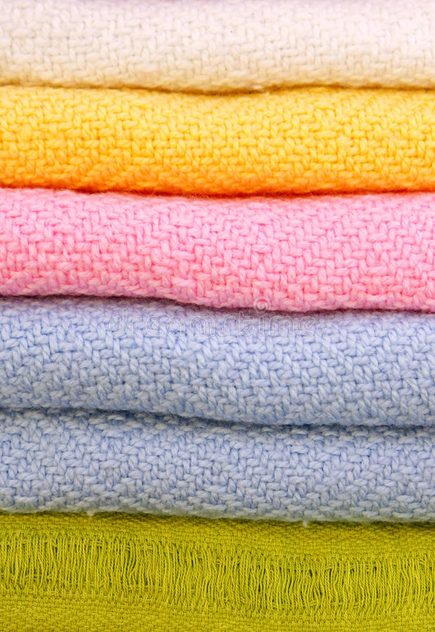 Pile of gentle folded shawls (scarfs) royalty free stock photo