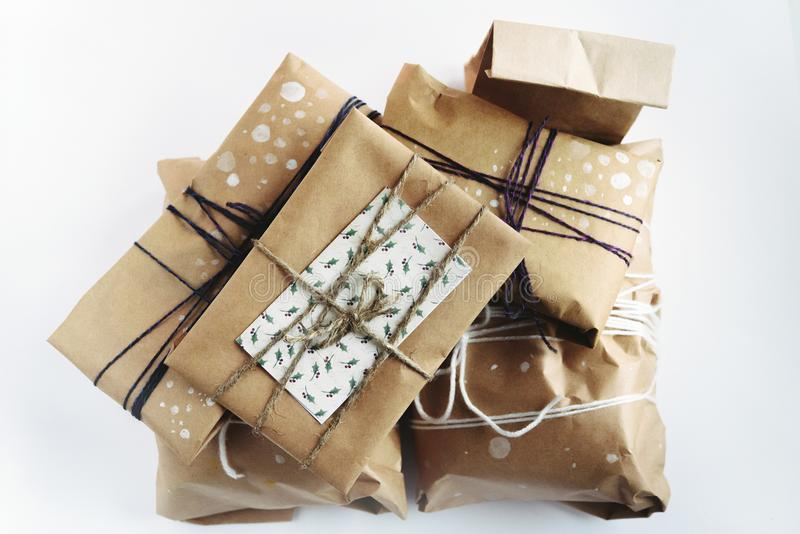 A pile of gift boxes in craft eco paper, handmade presents on wh stock images