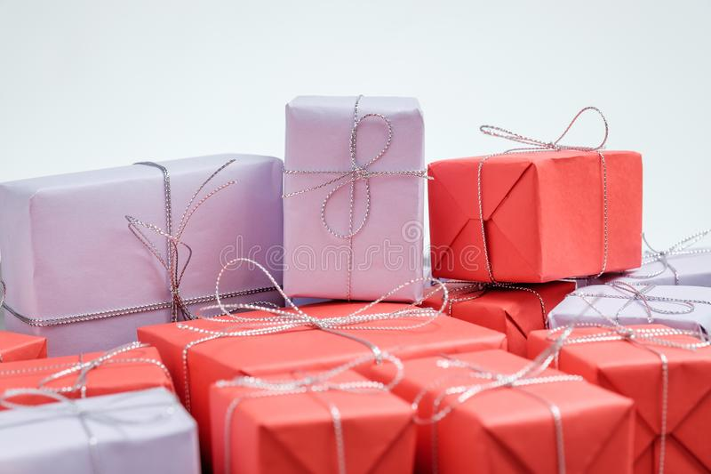 Pile of gifts wrapped in red and lilac paper royalty free stock photography