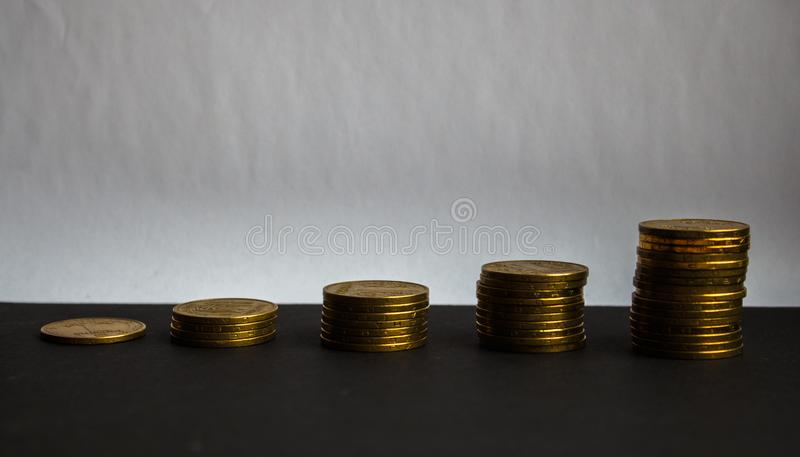 Pile of gold coins on white background stock photo
