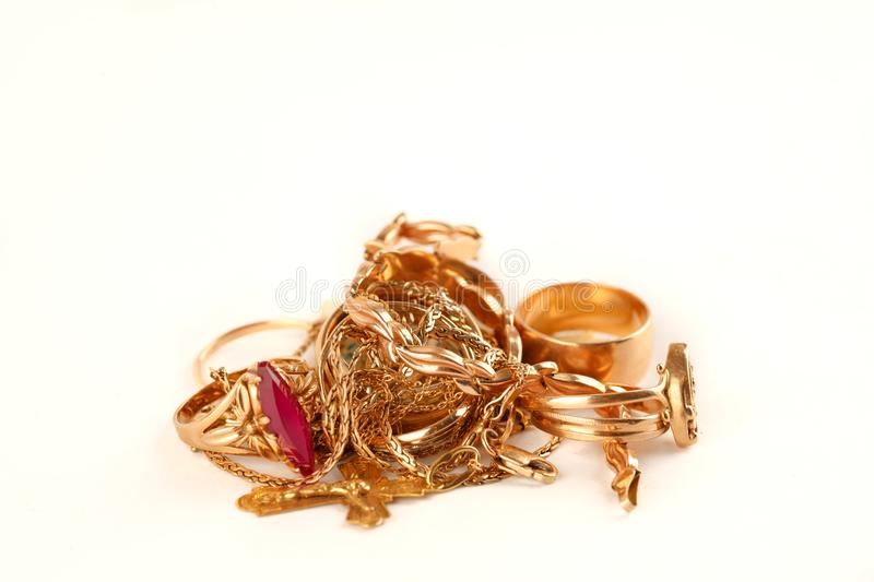 Pile of gold jewellery on a white background.  stock photography