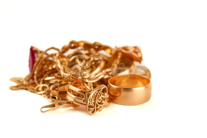 Pile of gold jewellery on a white background.  royalty free stock photo