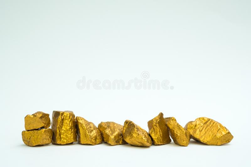 A pile of gold nuggets or gold ore on white background, precious. Stone or lump of golden stone, financial and business concept idea royalty free stock photography
