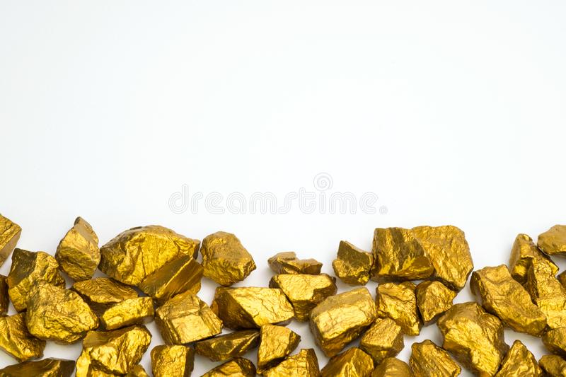 A pile of gold nuggets or gold ore on white background, precious. Stone or lump of golden stone, financial and business concept idea royalty free stock images