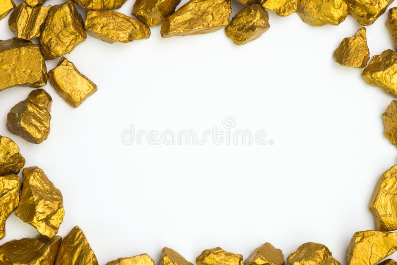 A pile of gold nuggets or gold ore on white background, precious. Stone or lump of golden stone, financial and business concept idea stock photo
