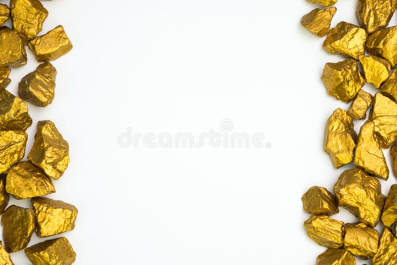 A pile of gold nuggets or gold ore on white background, precious. Stone or lump of golden stone, financial and business concept idea royalty free stock photos