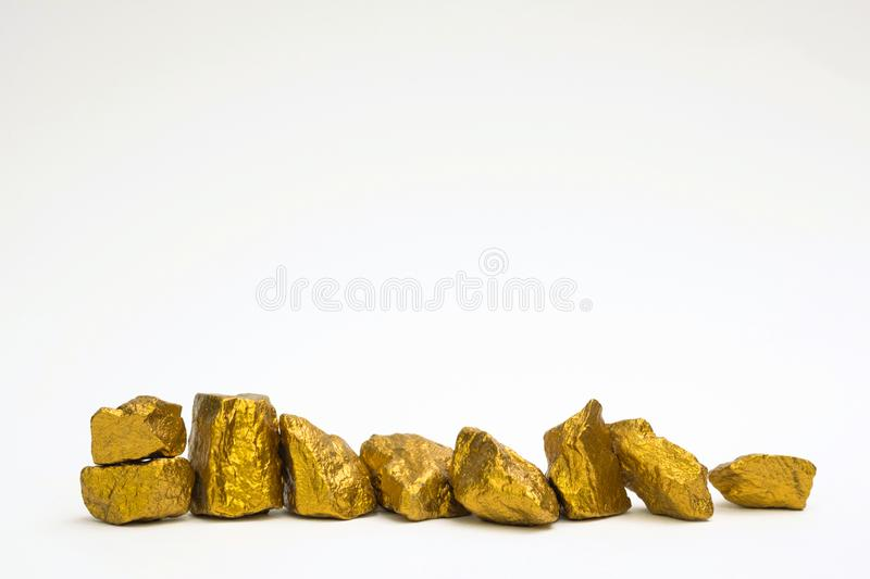A pile of gold nuggets or gold ore on white background, precious. Stone or lump of golden stone, financial and business concept idea royalty free stock image
