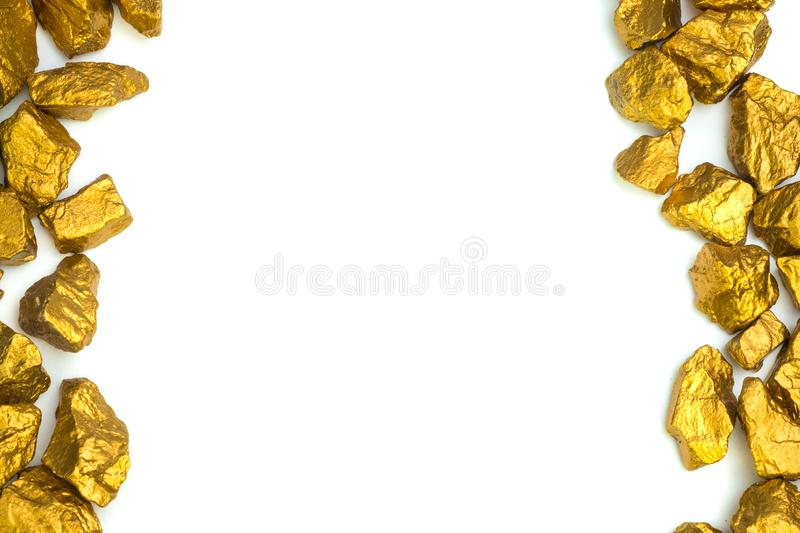 A pile of gold nuggets or gold ore on white background, precious. Stone or lump of golden stone, financial and business concept idea stock photography