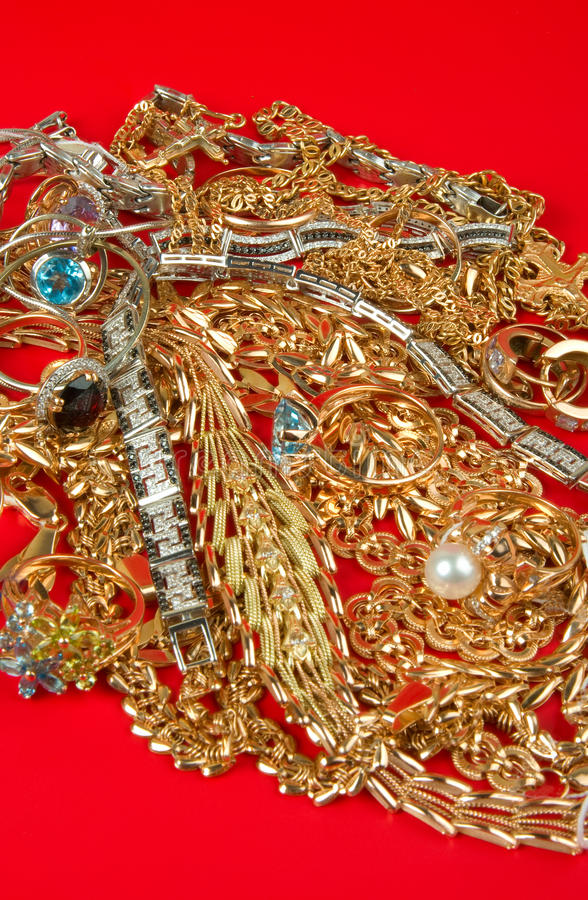 Download Pile Of Gold On A Red Stock Image - Image: 17005841