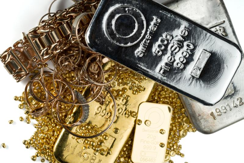 A pile of gold and silver bars, gold jewelry and gold granules. stock photos