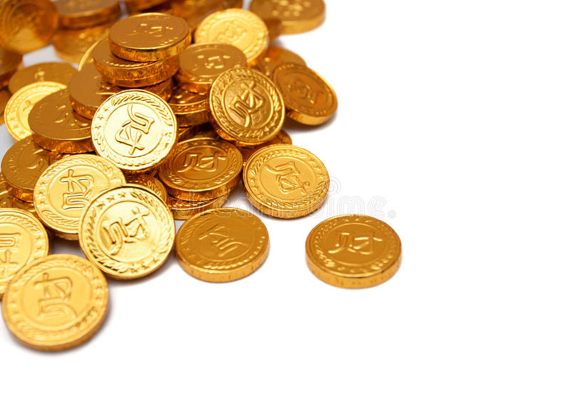 Pile of golden coin isolated on white background stock photography