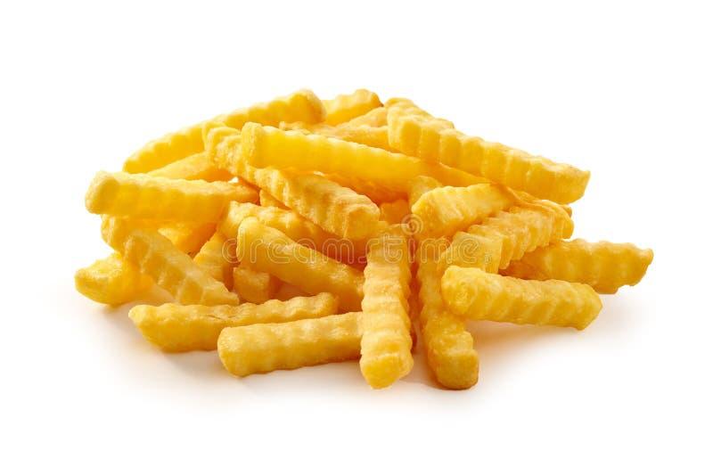 Pile of golden crispy crinkle cut Pommes Frites stock photos