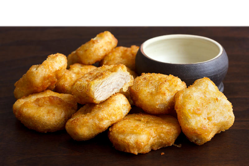 Pile of golden deep-fried battered chicken nuggets. stock images