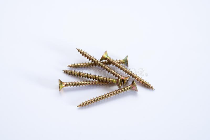 Pile of golden long screws royalty free stock photography