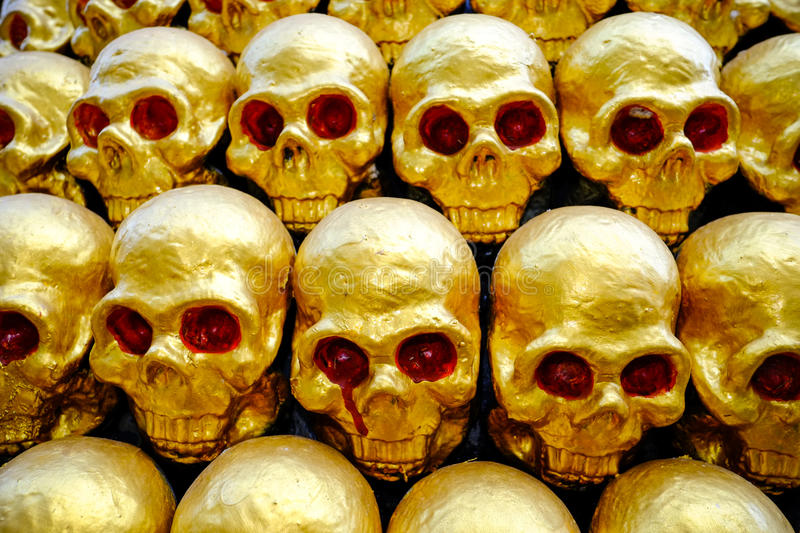 Download Pile Of Golden Skulls With Red Eyes. Closeup Stock Photo - Image of dead, bone: 38716132