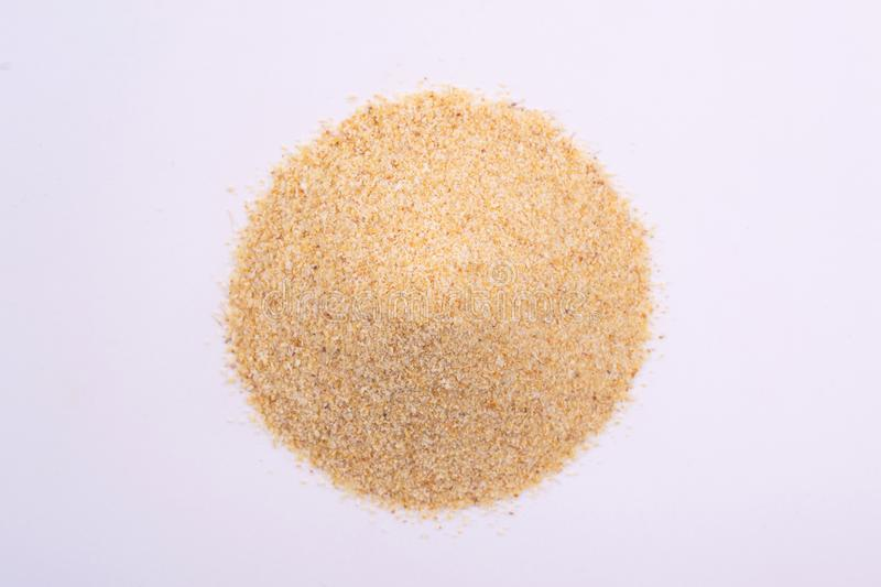A pile of granulated garlic powder stock image