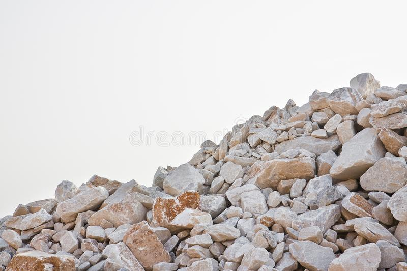 Pile of gravel, stones and cliffs of different sizes on white background for easy selection royalty free stock photos