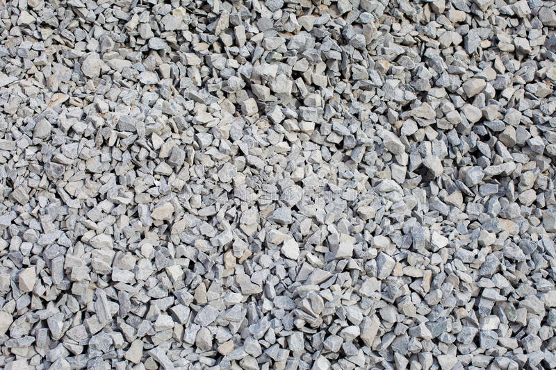 Pile of gray gravel closeup. Textural background stock photos