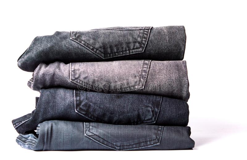 Pile of gray jeans isolated on white. Background royalty free stock images