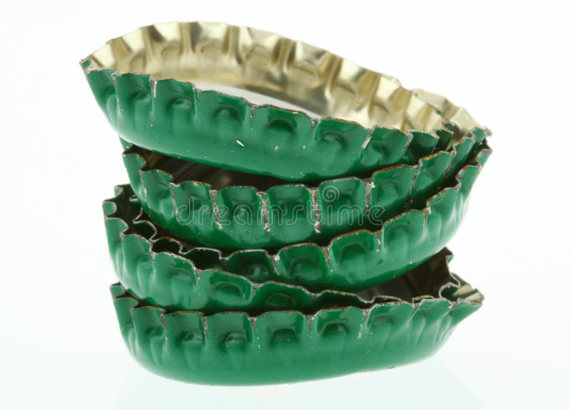 Pile of green beer caps stock image