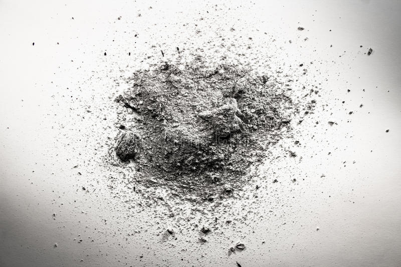 Pile of grey ash, dirt, sand, dust cloud, death remains. Background stock image