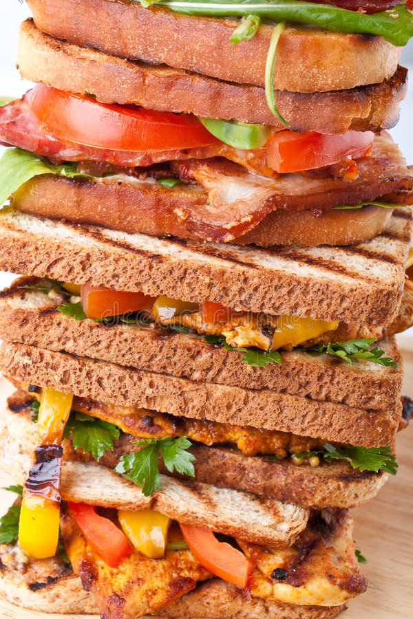 Pile of grilled BTL and chicken sandwiches stock images