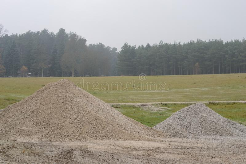Pile of grit. On the grass field royalty free stock images