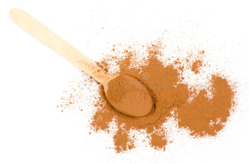 Pile of ground cinnamon on a white background wood spoon stock image