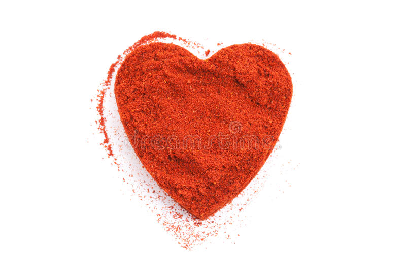 Pile of ground Paprika isolated in heart shape stock photos