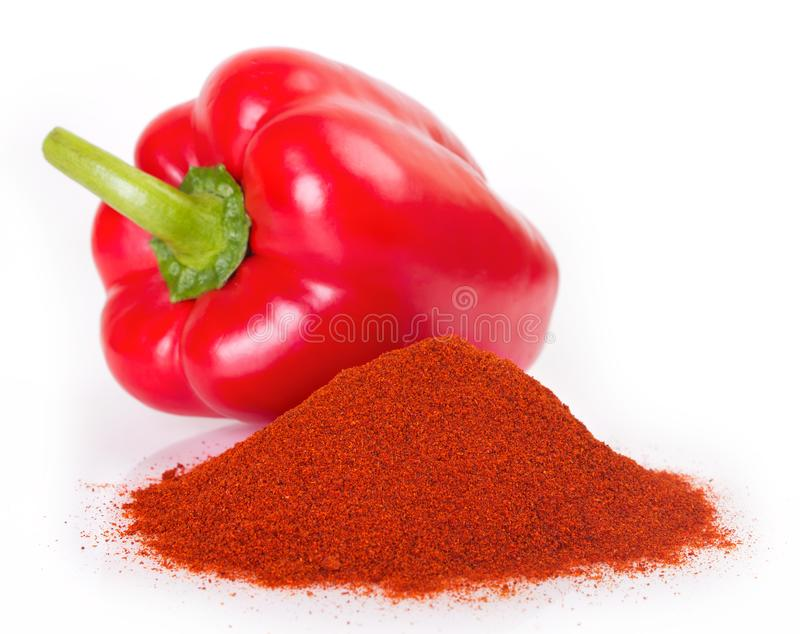 Pile of ground paprika with pepper. On white background stock photography